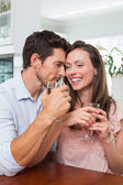 Happy couple with wine glasses at home — Stock Photo