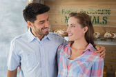 Couple with arm around at bakery — Stock Photo
