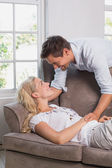 Happy casual couple in living room — Stock Photo
