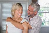 Mature man embracing a happy woman — Stock Photo