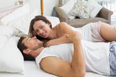 Happy relaxed couple together in bed — Photo