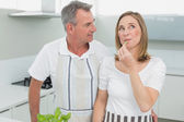 Content couple standing together in kitchen — Stock Photo