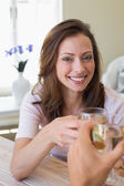 Smiling young woman toasting wine glass — Stock Photo