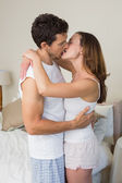 Loving young couple about to kiss at home — Stock Photo
