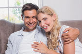 Portrait of relaxed cheerful loving couple at home — Stock Photo