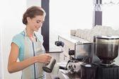 Female barista preparing espresso at coffee shop — Stockfoto