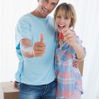 Happy couple holding new house key — Stock Photo #42600283