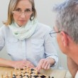 Couple playing chess at home — Stock Photo #42600293