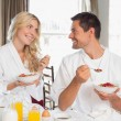 Couple looking at each other while having breakfast — Stock Photo