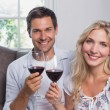 Young couple with wine glasses at home — Stock Photo #42601337