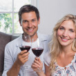 Young couple with wine glasses at home — Stock Photo