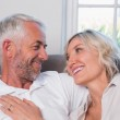 Happy mature couple relaxing on sofa — Stock Photo #42602321