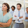 Business group with arms crossed in office — Stock Photo #42602593