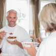 Mature man having breakfast with cropped woman — Stock Photo #42602639
