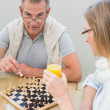 Couple playing chess at home — Stock Photo #42603451