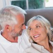 Close-up of happy relaxed mature couple on sofa — Stock Photo