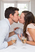 Loving young couple kissing at home — Stock Photo