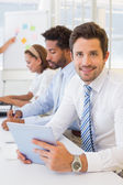 Businessman with colleagues in boardroom meeting — Stock Photo