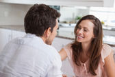 Close-up of a loving couple in kitchen — Stock Photo