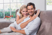 Portrait of relaxed loving couple sitting on sofa — Stock Photo