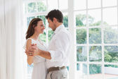 Loving young couple holding hands — Stock Photo