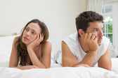 Couple not talking after an argument in bed — Stock Photo