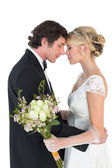 Newlywed couple standing head to head — Stock Photo