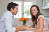 Portrait of a loving couple holding hands in kitchen — Stock Photo
