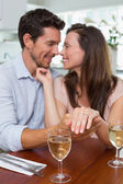 Woman showing engagement ring besides man — Stock Photo