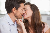 Loving young couple about to kiss — Stock Photo