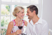 Happy loving couple with wine glasses looking at each other — Stock Photo
