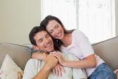 Portrait of a loving couple sitting on couch — Foto Stock