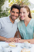 Portrait of a romantic couple at coffee shop — Stock Photo