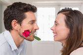 Loving couple looking at each other at home — Stock Photo