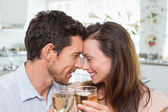 Loving couple with wine glasses at home — Stock Photo