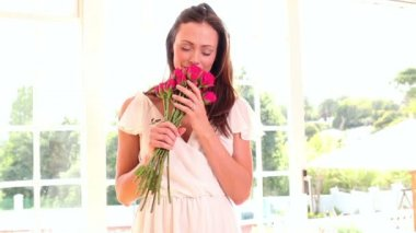Pretty woman smelling bouquet of roses — Stock Video