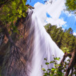 Waterfall bathed by sunbeams — Stock Photo