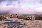 Man contemplating the rainbow — Stock Photo