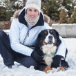 Woman and her pet in the snow — Stock Photo