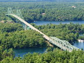 Long bridge in the middle of Canadian wood — Stock Photo