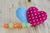 Spring sign with heart on the wood — Stock Photo