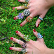 Stock Photo: Hands with colorful rings