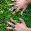 Hands with colorful rings — Stock Photo #30670425