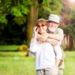 Senior couple smiling — Stock Photo #35590221