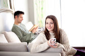 Young couple in a living room — Stock Photo
