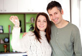 Happy young couple moving into a new home — Stock Photo