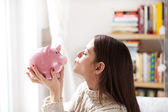 Kissing piggy bank — Stock Photo