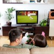Couple watching sport — Stock Photo