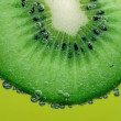 Kiwi with bubbles — Stock Photo