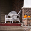 Chairs and pumpkins on a front porch — Stock Photo